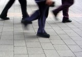 ... use three sets of legs walking on a cobbled path to show the new, horizontal, leader/-follower relationship.